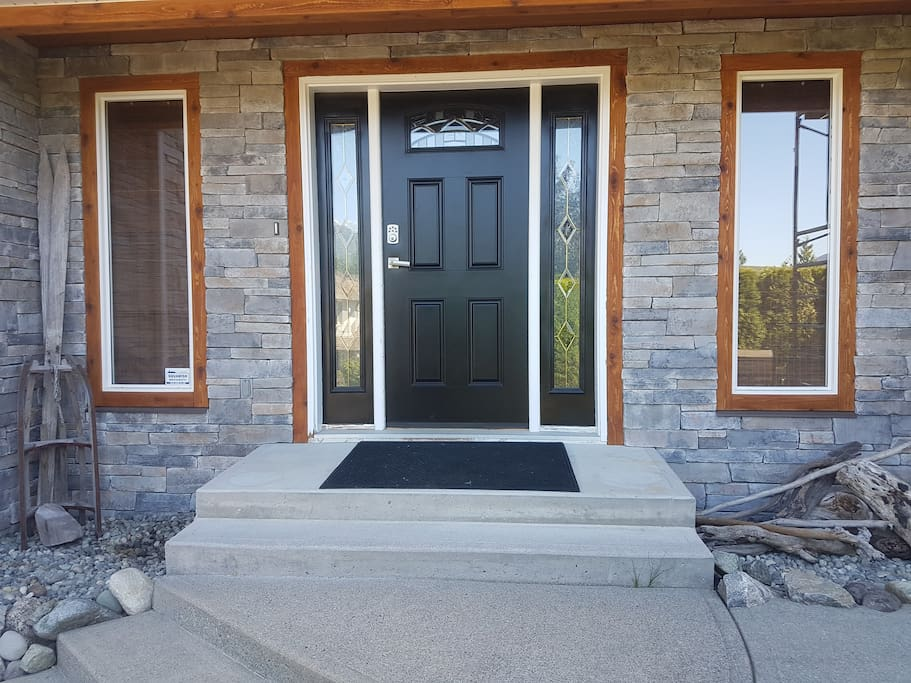 Gorgeous stone and cedar entry way