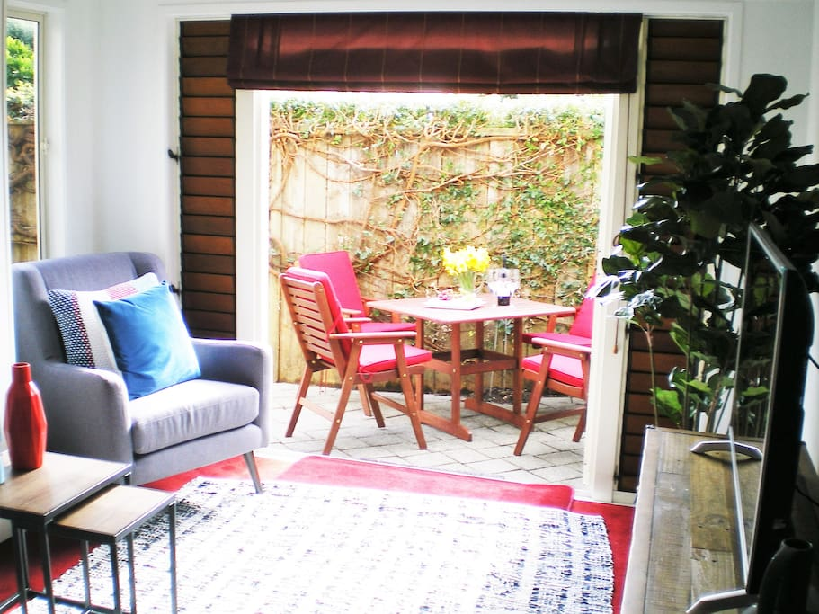 Lounge open plan to sunny patio