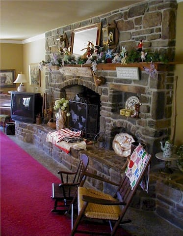 This is the living room fireplace designed by us when we bought the house with native stone.