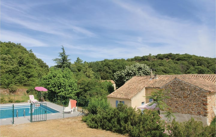 Beautiful home in St. Julien de Peyrolas with WiFi and 3 Bedrooms