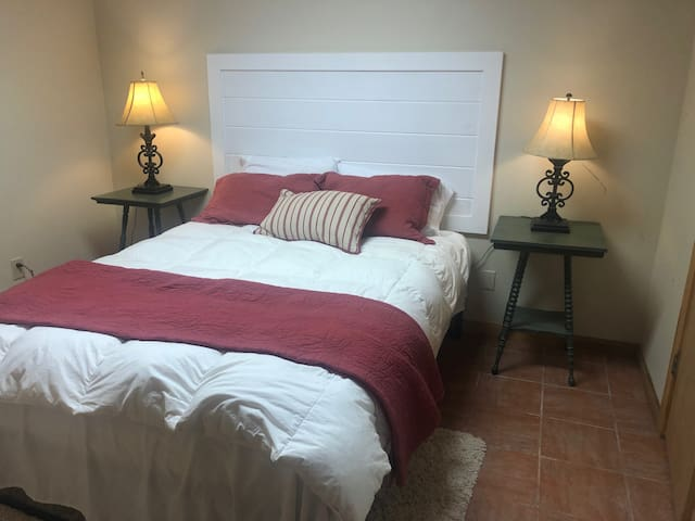 Private queen bedroom with private bath on the terrace level.