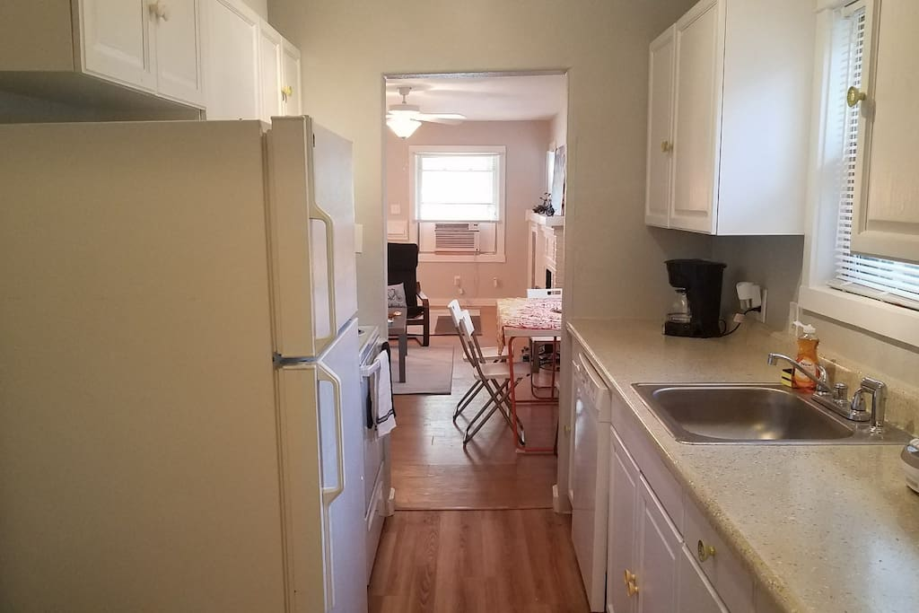 The newly-renovated kitchen has everything you need. Right off the kitchen is the dining area.