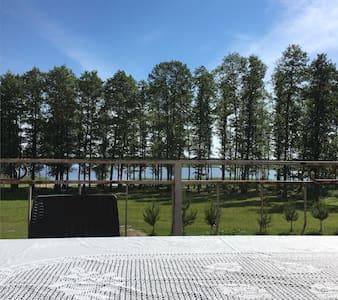Уютный дом в 50 метрах от озера
