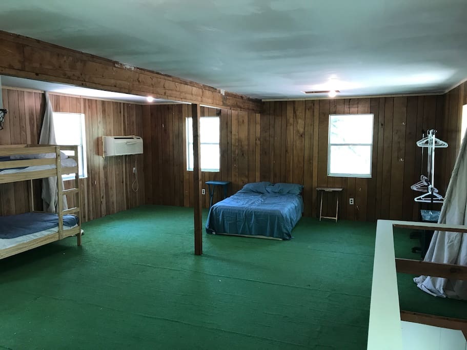 This photo shows a double bed and bunk bed.  There will also be a queen bed upstairs.  This is the view with the privacy curtains open.