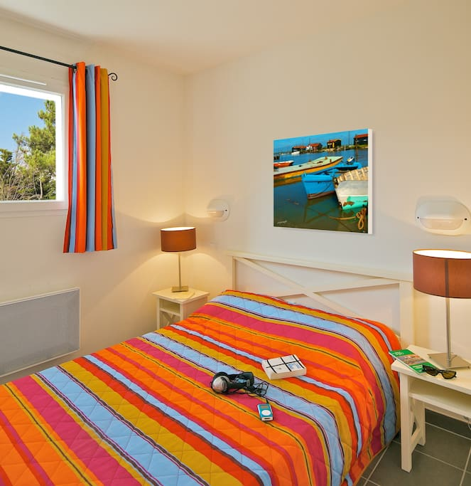 The master bedroom features a cozy Double bed.