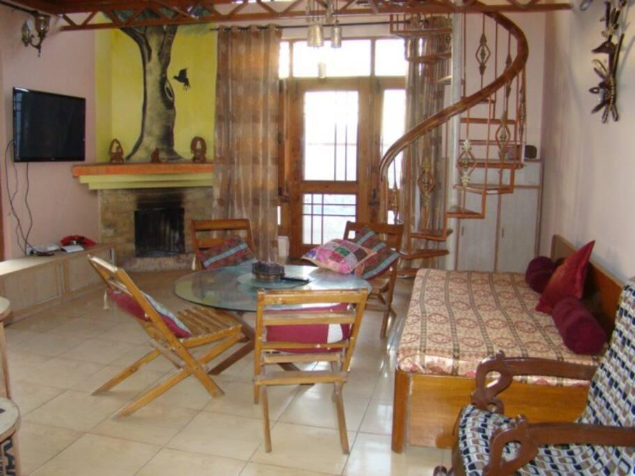 Spiraling Stairs from livingroom of lower floor to Bedroom on upper floor