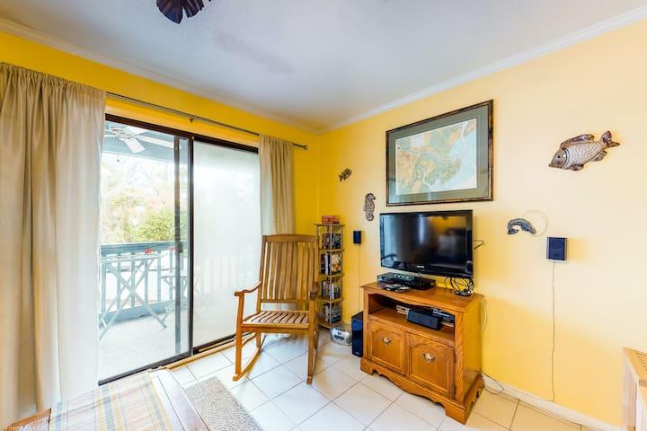 NEW LISTING! Island getaway w/ private balcony, shared pool, & easy beach access