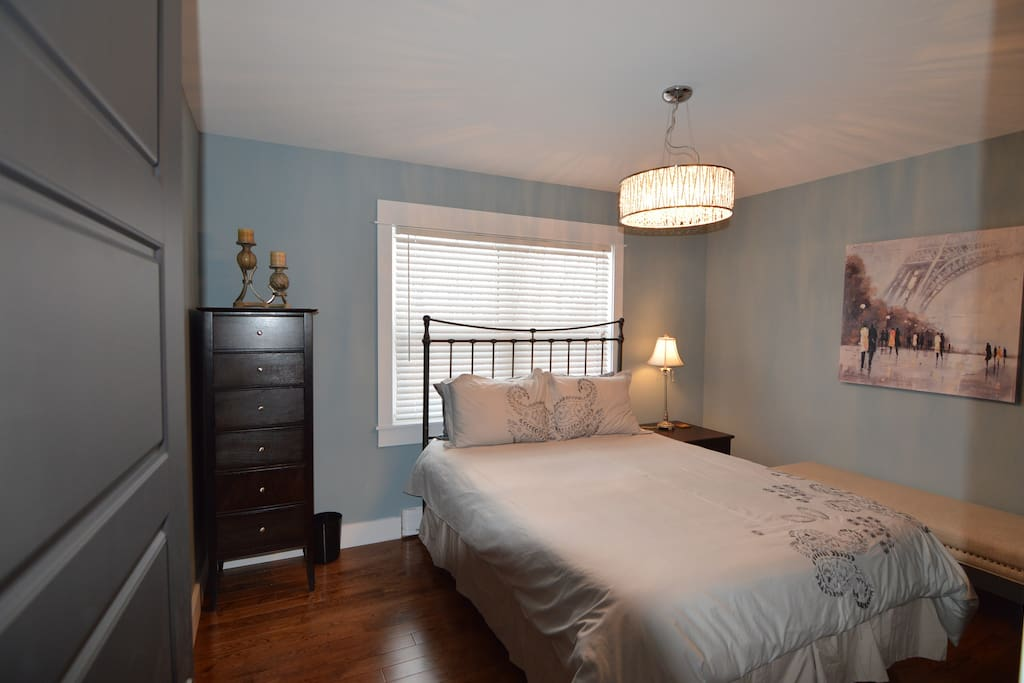 Master bedroom with queen bed overlooks back yard, has a large double closet with shelving and lots of space for storage.