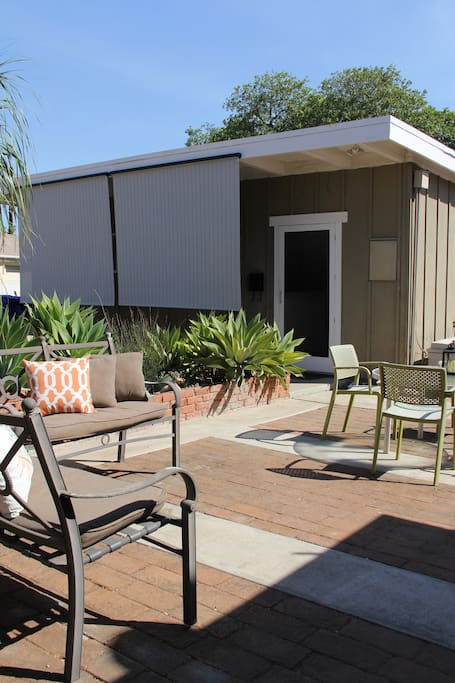 Private, backyard bungalow with sunshades and a/c to keep you cool.