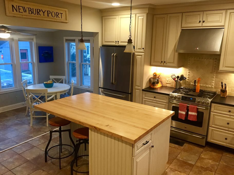 Gourmet kitchen with sunroom nook
