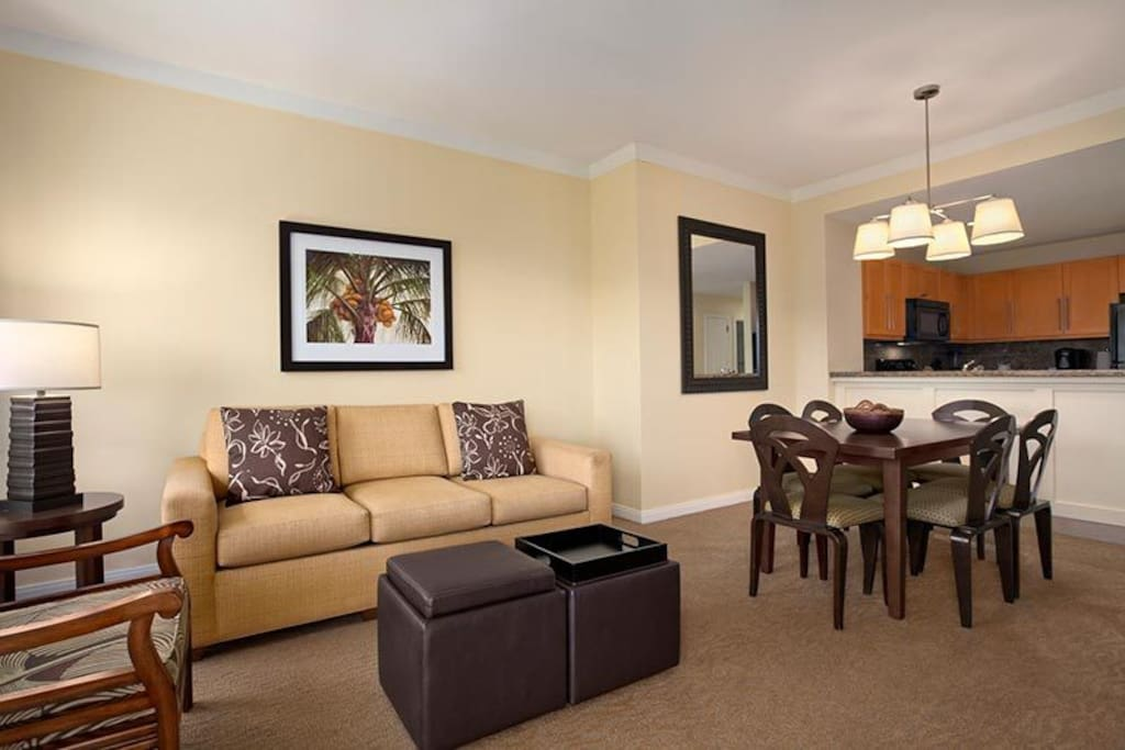 Lounge comfortably in the spacious living area with dining table (sofa pull out bed)
