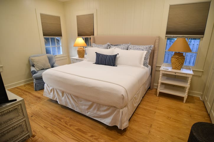 """Master bedroom equipped with a bed fit for a """"king"""""""