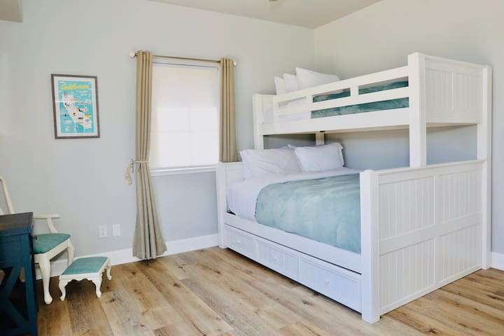 The Bunk room is equipped with a Queen bed, twin XL on top and twin XL in the trundle (under the bed).