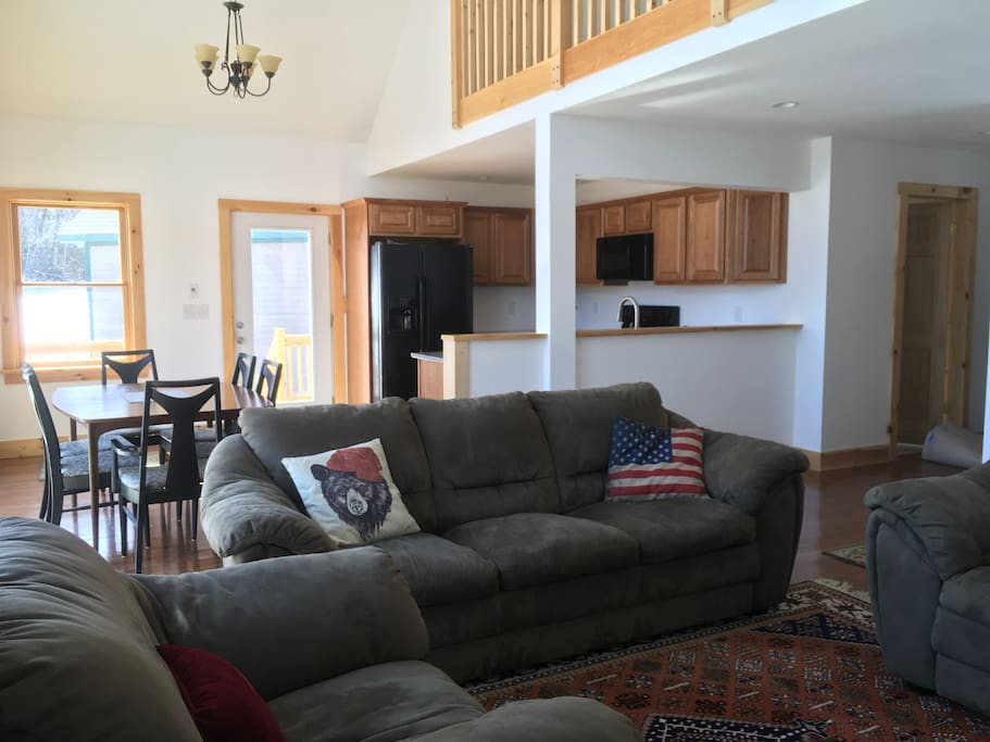 Include everyone in the conversation with the open area living space.  Comfy couches to relax in after a long day or skiing or hiking.