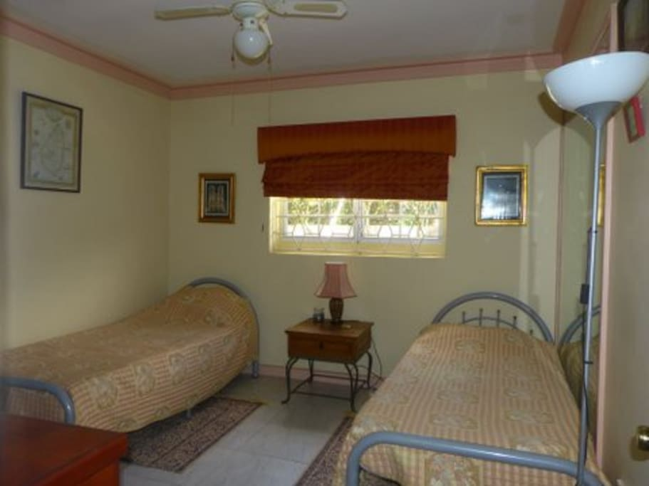 Twin Bedroom with large closet and en suite bathroom. No tv, hair dryer or iron