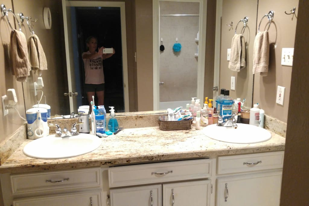 Bathroom has double sinks. guests get their own sink. Shower and toilet are seperate room. shower is newly remodeled with nice shower head