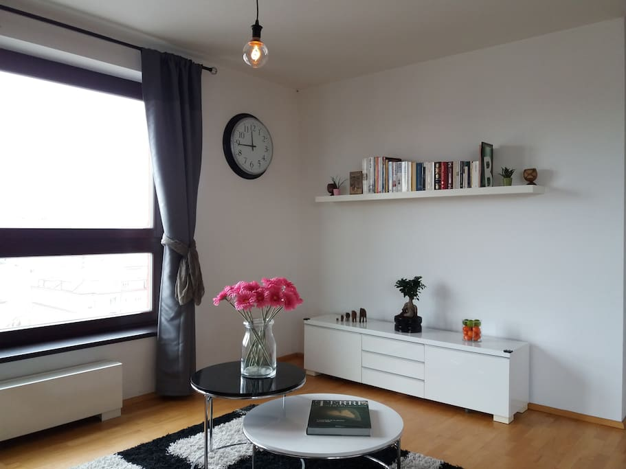 Living room corner with panoramic view over the Prague Castle.