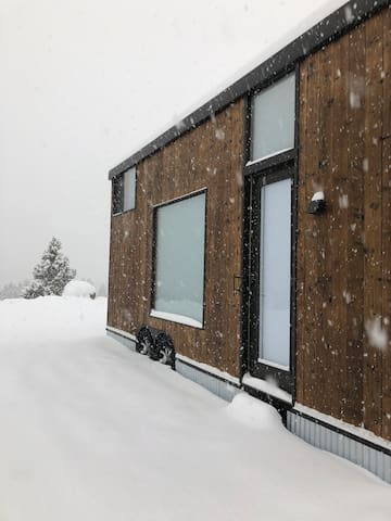 View of the entrance during a typical winter snow storm.