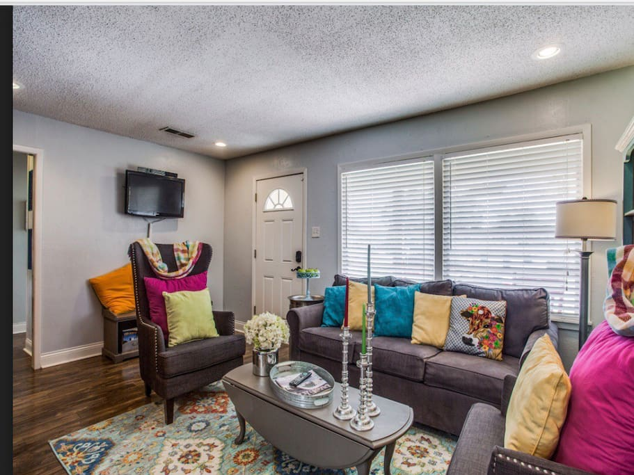 Welcome Home while in the Fort! Watch TV, catch up with friends, or play games in the bright and cheerful living room, which includes multiple areas of seating, full size sleeper sofa, and TV. Table also extends for dominoes and card games.