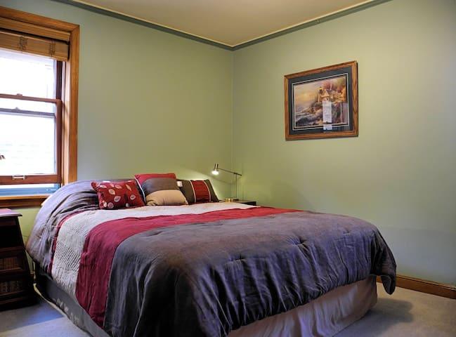 Smaller bedroom from cental hall