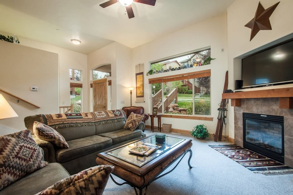"The living room features all the furnishings and technology you could want including large plush couches, gas fireplace and 60"" HDTV with Direct TV."