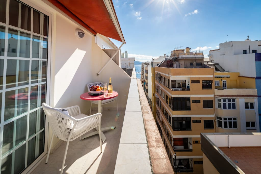 Top floor. Open terrace. Ideal for breakfast, dinner, reading or just lie back doing nothing. Just two blocks (130metres) from the sand of Las Canteras Beach
