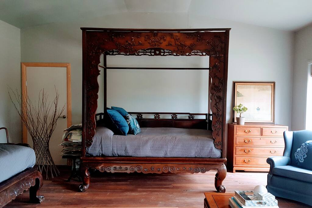 The marriage bed is a chinese antique and sleeps two grown ups.