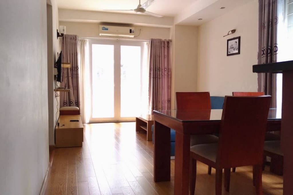 Living room is furnished with aircon, TV, sofa, water heater, working table, WIFI