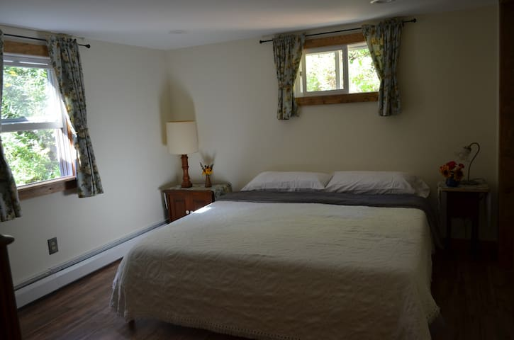 Master bedroom, on first floor, with king size memory foam bed.