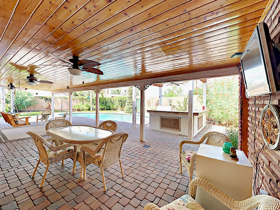The impressive patio with outdoor seating, kitchen and flat screen TV.