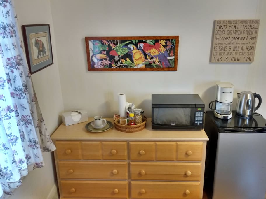 Dresser with six empty drawers, plus mini fridge, microwave, electric tea kettle, coffee maker and homemade granola breakfast.