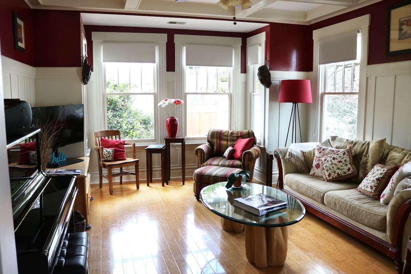 Living Room; Bright with Bay Window, Trees outside, Bamboo Floor, Piano and lots of comfortable seating.