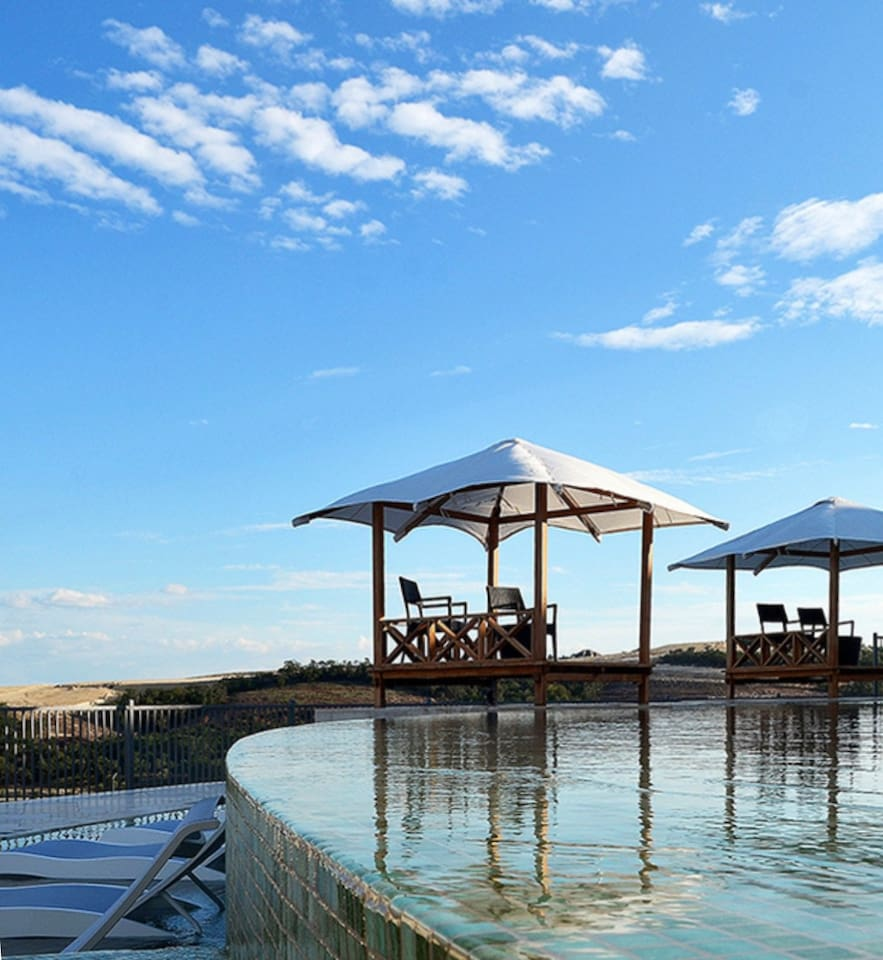Infinity pool provide hill country views from all sides.