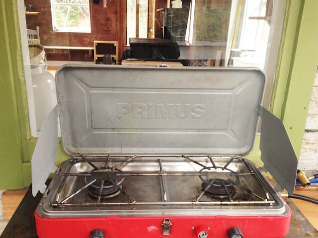The campstove in the summer kitchen (the winter wood porch!) is accessible if preferable to the wood stove.