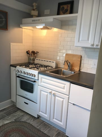Fully equipped Kitchen, center of apartment.  Small but efficient.  approx 8' x 10'.  Some storage.