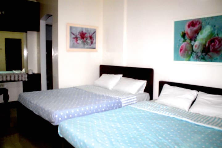 Private Room A / private bathroom. 2 queen sized beds. Holds 4-6 people