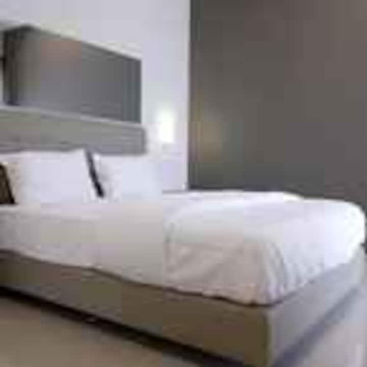 Charming Room at Guest House at Merdeka Selatan 3