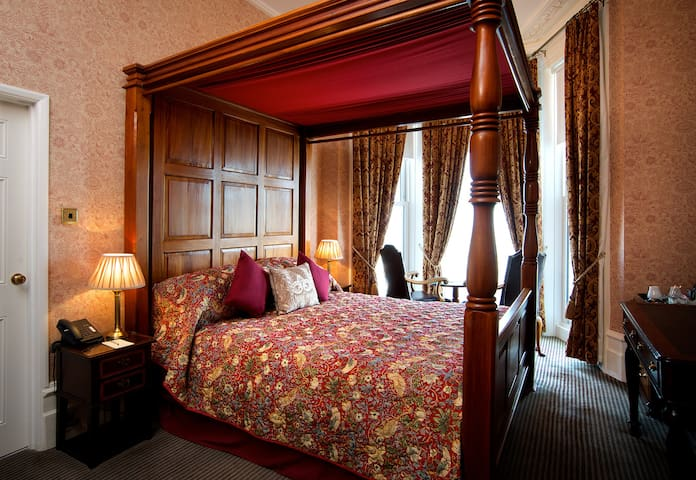 Four Poster Bedded Room with a sea view at the Premier AA Four Star Langham Hotel Eastbourne