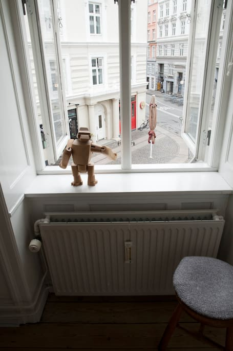 View of the street from the bedroom. This guy will keep you company. He's quiet and well grounded. Oh, that's a great café in the background by the way.