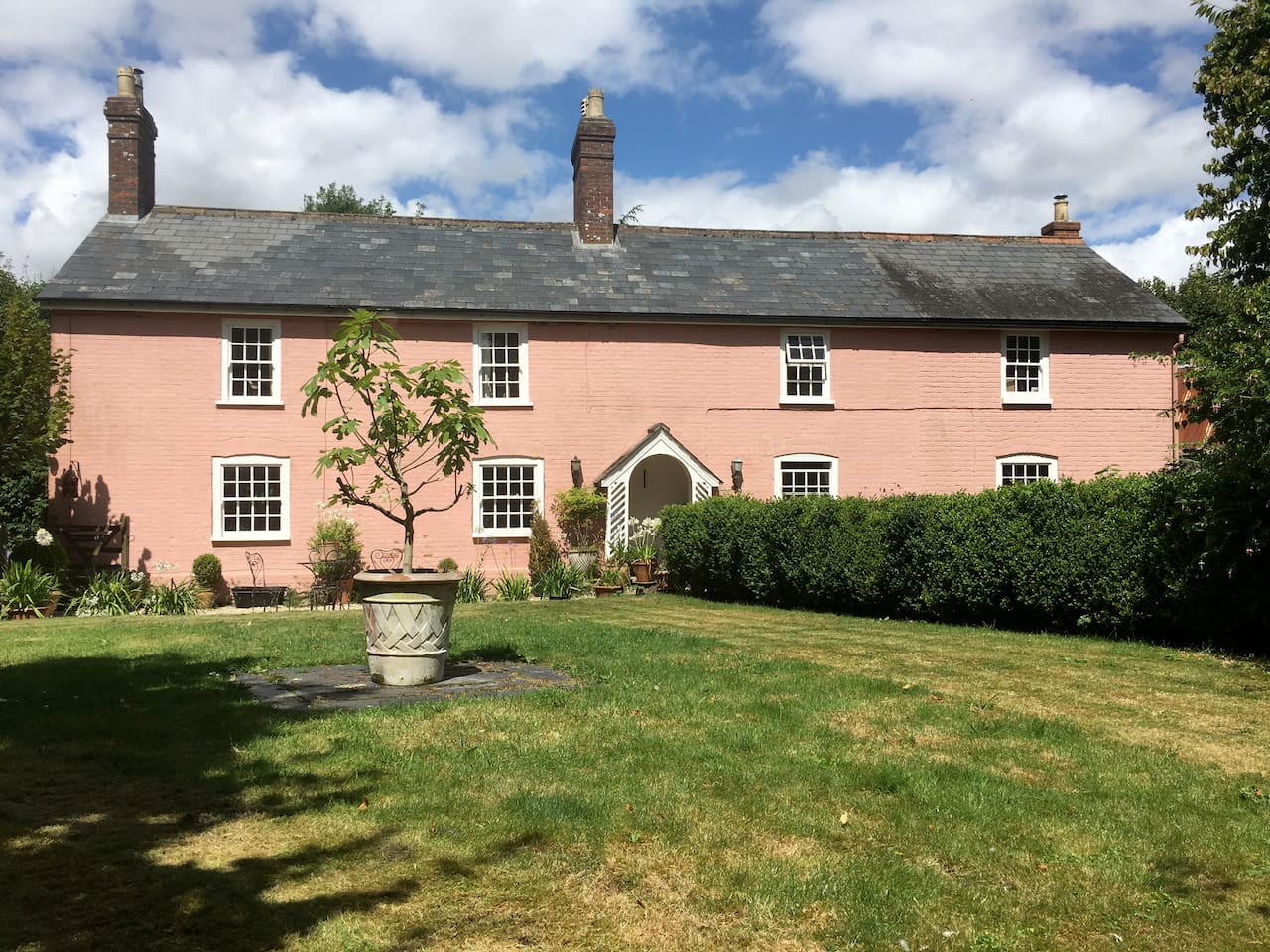 Beautifully restored Georgian farmhouse with cosy fireplaces and spacious rooms to relax in. Large landscaped garden and open barn for summer