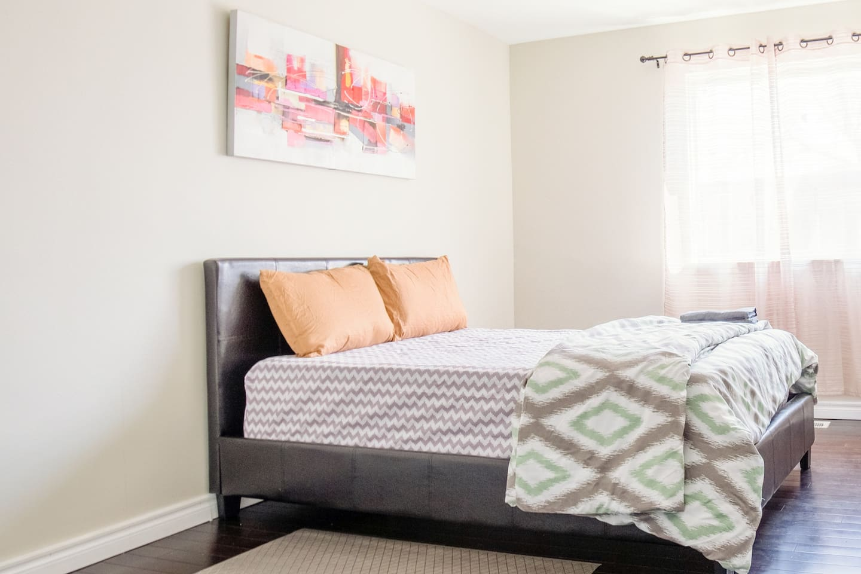 Queen Bed in Bright Bedroom