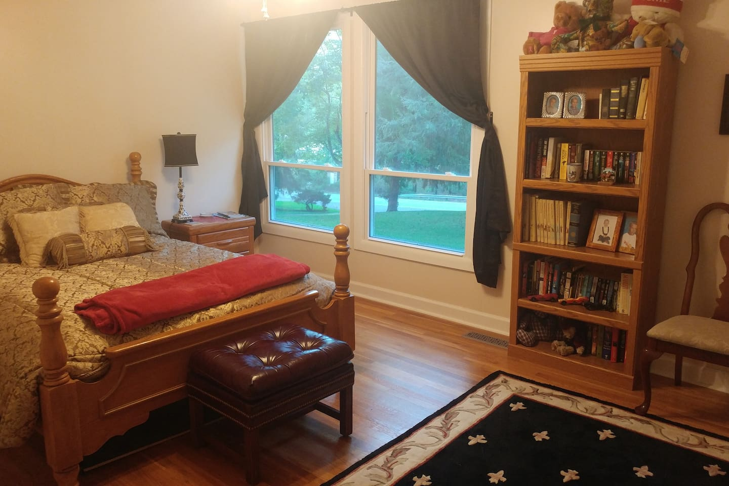 Spacious, airy room has queen bed and connects to a large bath. Curtains are light/heat/cold-blocking.