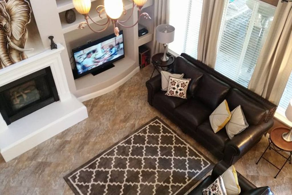 Open Concept Living Room with fireplace,  55'' Smart Plasma TV and Top Grain Leather Sofas