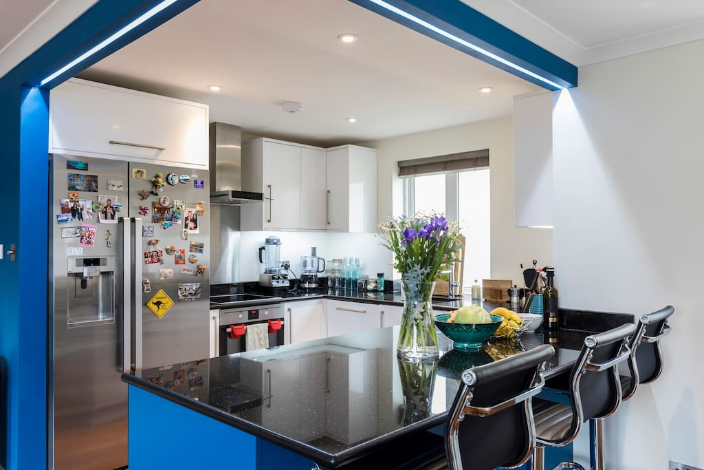 Fully loaded Kitchen with granite surfaces and latest technology including a  huge double door fridge, ice-maker and filtered water dispenser.
