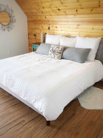 Brand New!! King bed with Douglas mattress in master bedroom