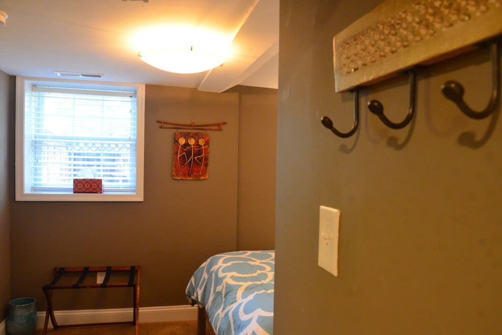 Practical space with lots of hooks, storage space, and a luggage rack