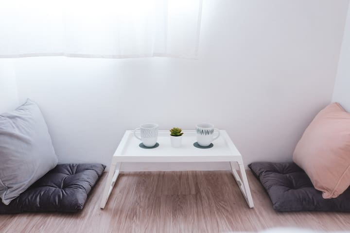 """Lesehan corner"" - a tatami style seating area on the floor. Use it to eat or just to chill with your travel partner."
