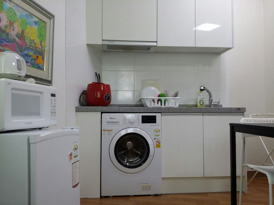 Built-in wash machine, refrigerator, microwave, rice cooker. water pot