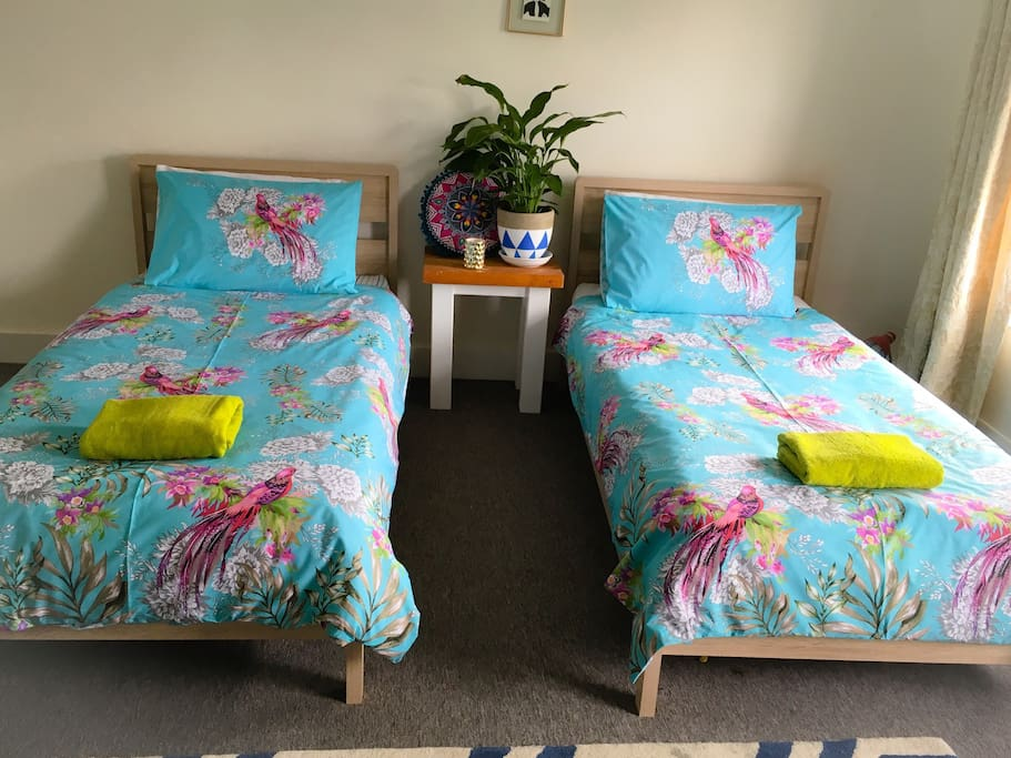 Twin beds in main bedroom can be pushed together to form a double bed, with a thick mattress topper and double bedding.