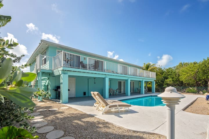 NEW LISTING! Great Middle Keys canal front home with pool!
